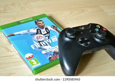 Warsaw, Poland - September 28 2018: FIFA 2019 for XBOX ONE. CD box with the game FIFA 2019 and XBOX ONE controller. First day, premiere.