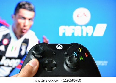 Warsaw, Poland - September 28 2018: FIFA 2019 for XBOX ONE. Blurred FIFA 2019 on TV screen and XBOX ONE controller. First day, premiere.