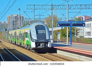 WARSAW, POLAND - SEPTEMBER 29, 2018 - 'Elf' EMU train, produced by Pesa, in Koleje Mazowieckie livery, at Warszawa Gdanska railway station