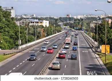 WARSAW, POLAND - SEPTEMBER 8, 2010: Heavy freeway traffic in Warsaw, Poland. European road E30 (national road 2) is one of most important traffic arteries in Warsaw.