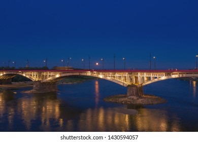 Warsaw Poland, twilight view of the Lazienkowski brigde over the Vistula river.