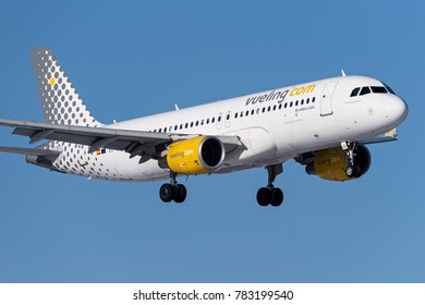 WARSAW, POLAND: Vueling Airlines, Airbus A320 (registration EC-LVX) landing at Warsaw Chopin Airport - WAW. February 10, 2017.