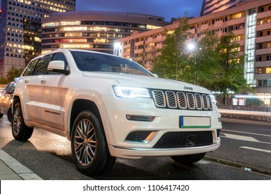 Warsaw, Poland-April 2018: New SUV Jeep Grand Cherokee model against the background of modern buildings in Warsaw