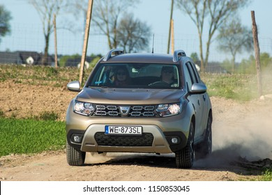 Warsaw, Poland-April 2018-A new model of a small suv-Dacia Duster during dynamic driving on dirt roads