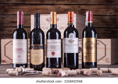 WARSAW, POLAND-DEC 20, 2018: A branded set of wines in arrangement with corks and a wooden box