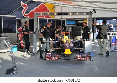 "WARSAW - SEPTEMBER 04: Red Bull Racing mechanics, working on Mark Webber's car, after his demonstration ride, during the ""Red Bull As w Karcie"" on September 04, 2010 in Warsaw, Poland"
