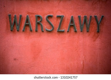Warsaw sign in Polish on wall in the capital city