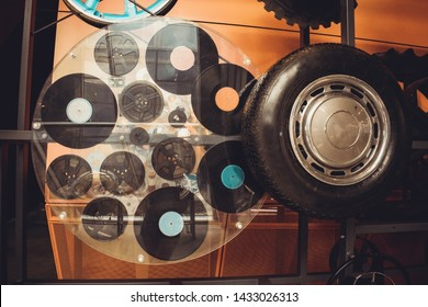 Warsaw/Poland - 06/20/2019: Installation with car wheel and vinyl records. Retro background.
