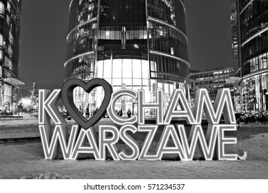 Warsaw,Poland. 18 January 2017. 'Kocham Warszawe' ('I love Warsaw') LED light sign as part of an illumination of modern business complex by Warsaw Spire skyscraper. Black and white
