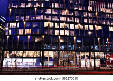 Warsaw,Poland. 21 February 2017. Office building Proximo. Buildings at night and  roving car with blur light through city at night