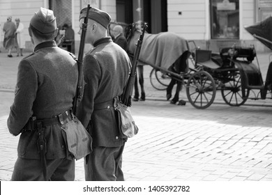 Warsaw/Poland - 5 May 2019: Retro movie scene with old-timer cars, bicycle and people on a street.  Shooting film in Warsaw, Poland. Times of War. Retro concept. Film making. Filming movie scene.