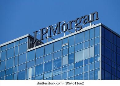 Warsaw/Poland, April 8, 2018: Spring sun shining on J.P. Morgan logotype on top of headquarters