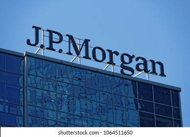 Warsaw/Poland, April 8, 2018: Sun is reflected in J.P. Morgan headquarters glass facade
