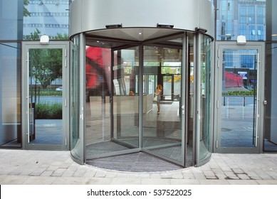 Warsaw,Poland. August 2016.Revolving glass doors on glass walled building