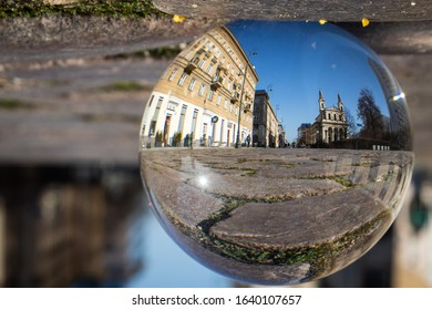 WARSAW/POLAND - FEBRUARY 8, 2020: View on Chlodna street and st. Borromeo church trough refraction glass ball