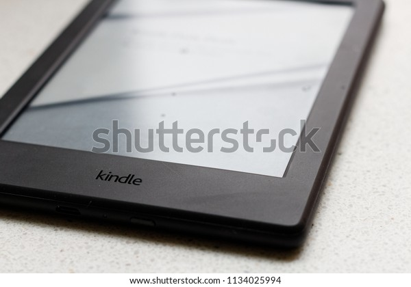 WARSAW/POLAND - JULY 14, 2018: View on Amazon Kindle 8 ebook reader with reflection on screen