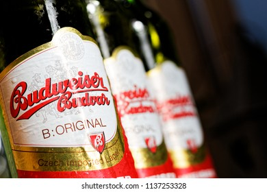 WARSAW/POLAND - JULY 18, 2018: View on three labels of Budweiser Budvar - premium export lager beer and pinta on the table