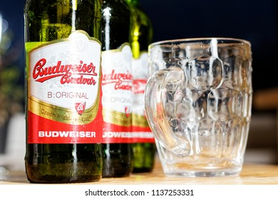 WARSAW/POLAND - JULY 18, 2018: View on three bottles of Budweiser Budvar - premium export lager beer and pinta on the table