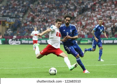 WARSAW,POLAND- JUNE 8,2012:Robert Lewandowski and Giorgos Samaras during the game between Greece and Poland for Euro 2012 in Warsaw on June 8,2012