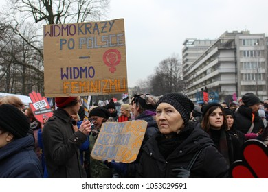 """Warsaw/Poland - March 23 2018: thousands of people protesting against the tightening of the abortion law in Warsaw, Poland """"the specter is circulating in Poland - the specter of feminism"""" sign"""