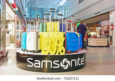WARSAW/POLAND - SEPT. 1, 2017: An assortment of Samsonite luggage fashionably  stacked on a cylindrical base in a local shop at the Warsaw Chopin Airport. Warsaw, Poland