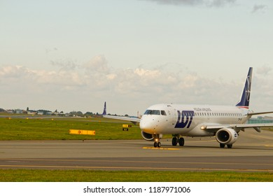 WARSAW/POLAND - SEPTEMBER 22, 2018: View on Embraer ERJ-195LR of LOT - Polish Airlines on the runaway at Frederic Chopin Airport