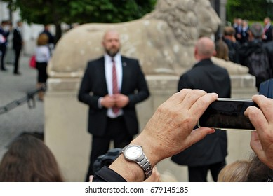 Warsaw,Poland.17 July 2017. Visit of the royal couple in Warsaw. People taking photos of the royal couple. People holding Union Jack flags and flowers