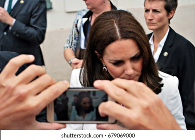 Warsaw,Poland.17 July 2017.Kate Middleton greeting crowds in Warsaw. People cheering for Kate and William. People are taking photos. Blurred background.