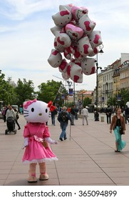 WARSAW,POLAND-MAY 16: Unidentified Balloon seller in Hello Kitty Costume selling Balloons.May 16,2015 in Warsaw,Poland.