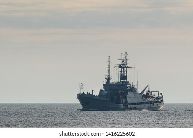 WARSHIP ON THE SEA - A search and rescue ship in the morning sun