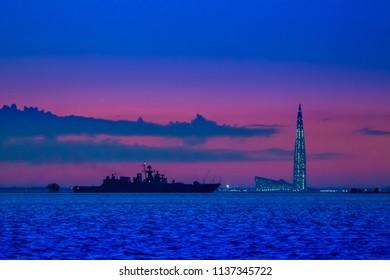 The warship sails at dusk. Rocket cruiser.