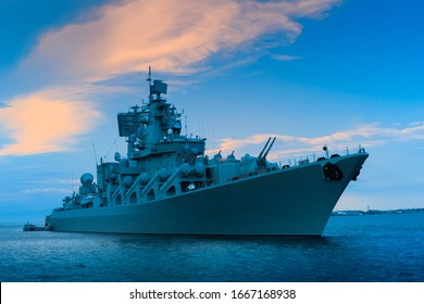 Warship. A ship with a lot of guns on board. Naval forces. Ship for military operations. Sea ship near the city. Transplanting people from vessel to vessel. Concept - Russian arms. Ocean