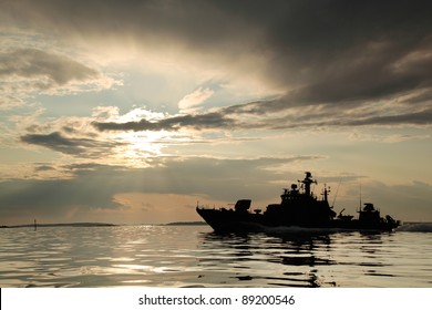 Warship with threatening sky