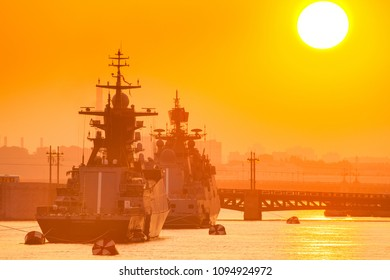 Warships. Caravan of military ships. Missile cruisers. Ships in the roadstead. The warships are in the fairway.