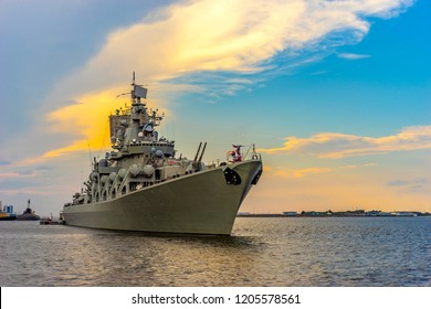 Warships. Missile cruiser. Protection of maritime borders of the state. Ship against the clouds.