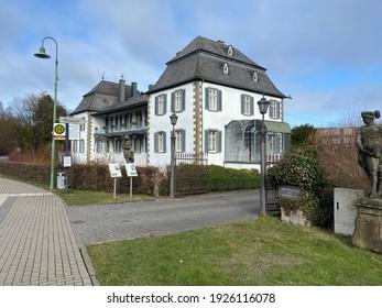 """Warstein, NRW, Germany - 02.28.2021 : Museum """"Kupferhammer"""" in the downtown of Warstein in the Sauerland area."""