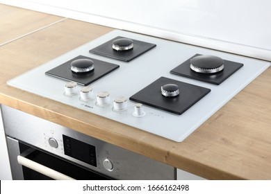 Warszawa, Poland January 17 2020:Gas hob BOSCH PPP612M91E. Burners on a white glass gas stove in the kitchen. Top view. Hob without grills.Burners on a white glass gas cooker in the kitchen.