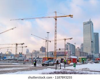 WARSZAWA, POLAND - JANUARY 22, 2004: Construction cranes and glass skyscrapers in Warszawa, Poland.