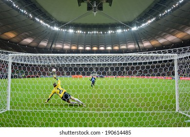 WARSZAWA, POLAND - MAY 02, 2014: Jorge Kadu shotting penalty kick to goalkeeper Silvio Rodic during the Polish Cup Final Zawisza Bydgoszcz - KGHM Zaglebie Lubin 6:5 (0:0).