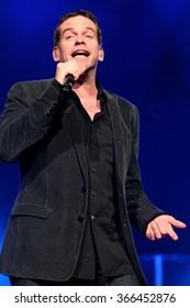 WARSZAWA, POLAND - NOVEMBER 26: Canadian singer Garou sings at a concert in Warsaw, Poland on November 26 , 2008