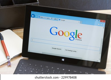 WARSZAWA, POLAND - OCTOBER 10, 2014. Google search page on screen of Windows tablet Surface.  In December 2013 Alexa listed google.com as the most visited website in the world.