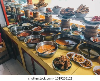 Warung Nasi Padang, Padang rice curry one of the most famous meals to be associated with Indonesia, a mix of rice and side dishes, originally from the Padang. Indonesian Culinary Food
