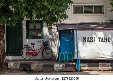 Warung Nasih Tahu, a view from nasi tahu booth which built in the side walk in Kudus, Jawa Tengah, Indonesia