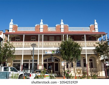 WARWICK, AUSTRALIA – March 12, 2018: View of The Langham Hotel, built in 1912-13, and its filigreed verandah, archways and pilasters, in Warwick, Australia