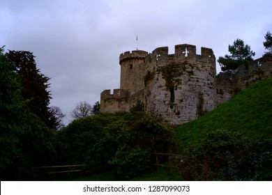 Warwick Castle in England in a cloudy day.