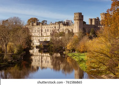 Warwick castle on the river Avon warm autumn day fall colours, Warwick, Warwickshire, England, UK, November 2017