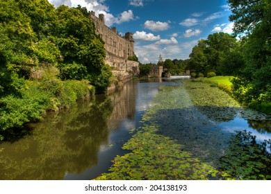 Warwick Castle and the river Avon in Warwick, England on a bright, sunny, summer day