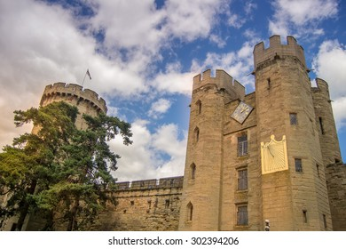 Warwick castle in Warwickshire, England with a dramatic sky in the background.
