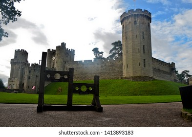 Warwick, England, United Kingdom - September 30, 2016: A medieval wooden pillory sits in front of Warwick Castle in England, UK.