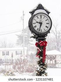 Warwick, NY / United States - December 17, 2016: Warwick's Railroad Green Post Clock after snowstorm.